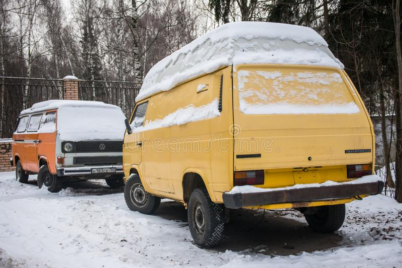 MOSCOW, RUSSIA,DECEMBER,4.2018 :Old abandoned cars covered with a layer of snow, parked in the city Park stock photo