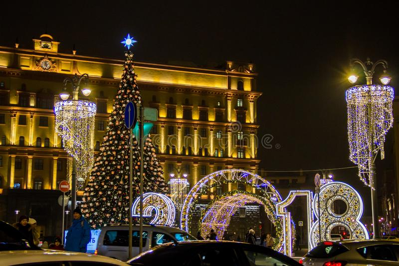 MOSCOW, RUSSIA - DECEMBER 21, 2017: People and tourists walk along street decorated for New Year and Christmas. Holidays near Kremlin. Festival Christmas light royalty free stock photos