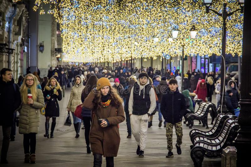 MOSCOW, RUSSIA - DECEMBER 21, 2017: People and tourists walk along street decorated for New Year and Christmas. Holidays near Kremlin. Festival Christmas light royalty free stock photography