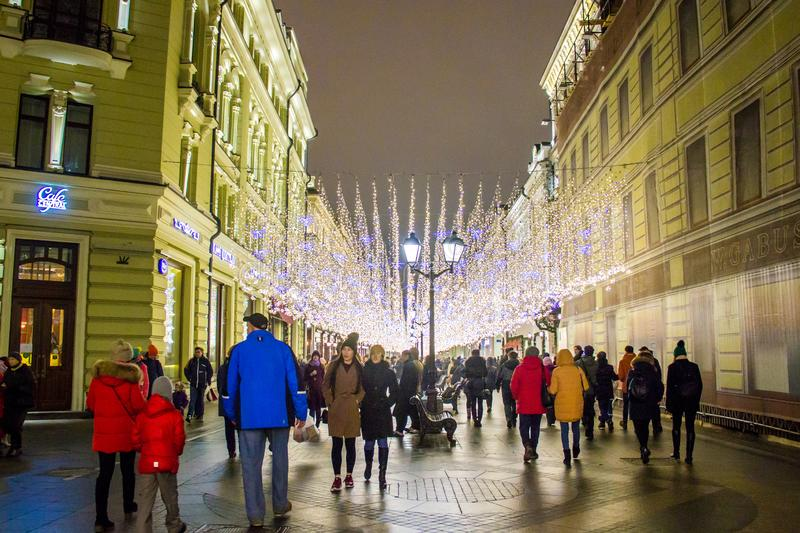MOSCOW, RUSSIA - DECEMBER 21, 2017: People and tourists walk along street decorated for New Year and Christmas. Holidays near Kremlin. Festival Christmas light stock photo