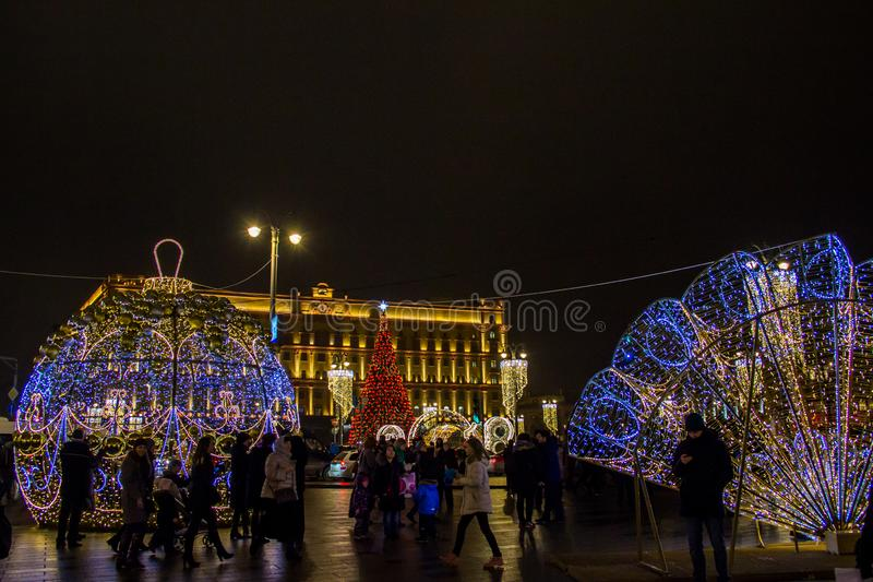 MOSCOW, RUSSIA - DECEMBER 21, 2017: People and tourists walk along street decorated for New Year and Christmas. Holidays near Kremlin. Festival Christmas light stock images