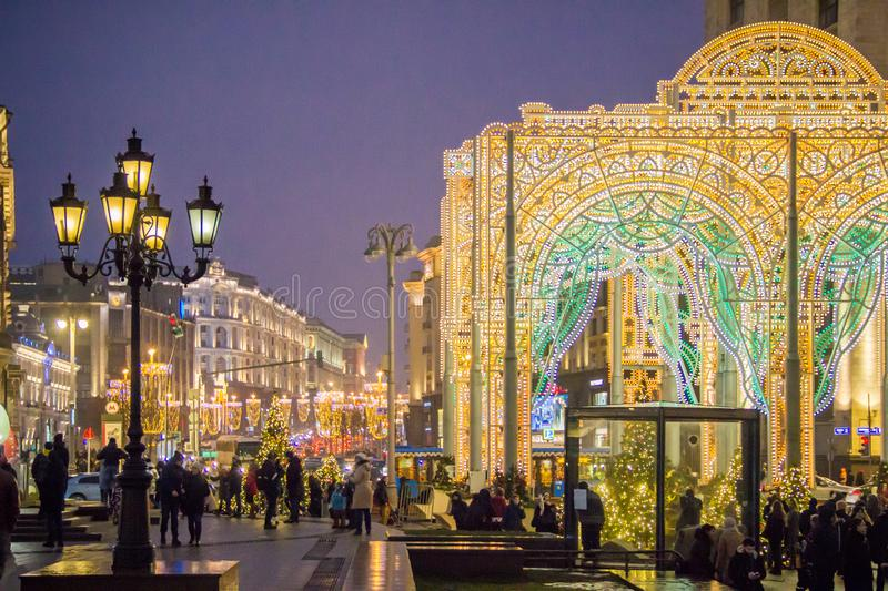 MOSCOW, RUSSIA - DECEMBER 21, 2017: People and tourists walk along street decorated for New Year and Christmas. Holidays near Kremlin. Festival Christmas light royalty free stock photo