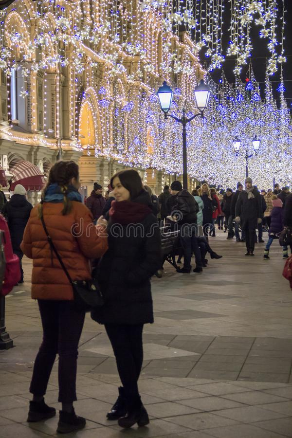 MOSCOW, RUSSIA - DECEMBER 21, 2017: People and tourists walk along street decorated for New Year and Christmas. Holidays near Kremlin. Festival Christmas light stock image