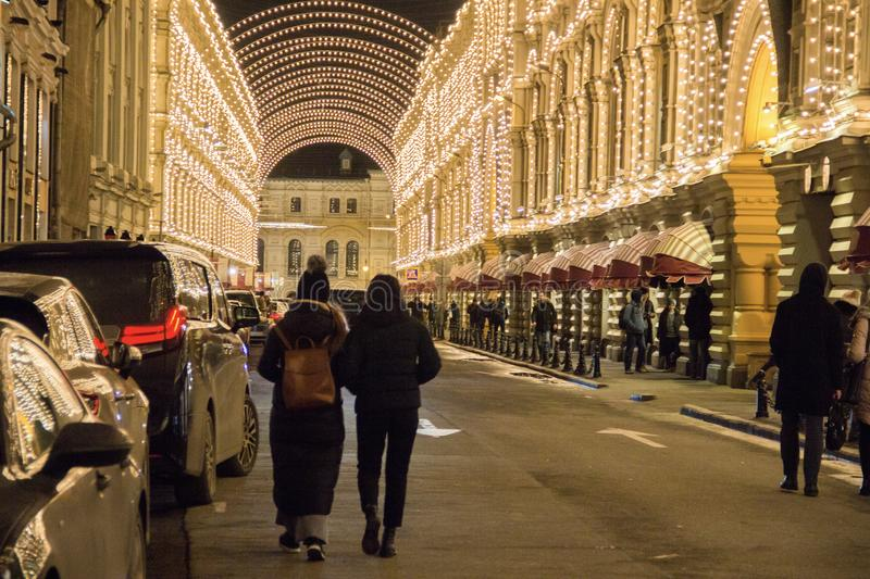 MOSCOW, RUSSIA - DECEMBER 21, 2017: People and tourists walk along street decorated for New Year and Christmas. Holidays near Kremlin. Festival Christmas light stock photos