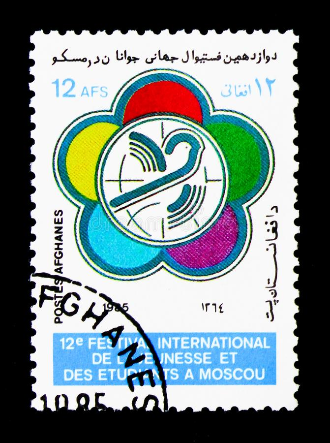 Festival emblem, 12th World Youth and Students' Festival, Moscow. MOSCOW, RUSSIA - DECEMBER 21, 2017: A stamp printed in Afghanistan shows Festival emblem, 12th royalty free stock photos