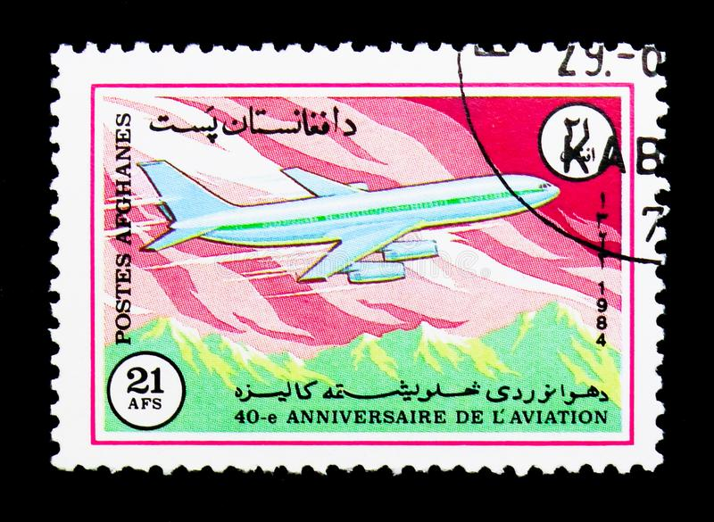 Ilyushin Il-86 plane, 40th Anniversary of Ariana Airline serie,. MOSCOW, RUSSIA - DECEMBER 21, 2017: A stamp printed in Afghanistan shows Ilyushin Il-86 plane stock image