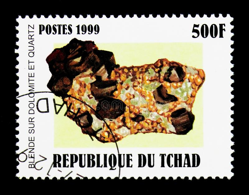 Dolomite and quartz, Minerals serie, circa 2000. MOSCOW, RUSSIA - DECEMBER 21, 2017: A stamp printed in Chad shows Dolomite and quartz, Minerals serie, circa stock photos