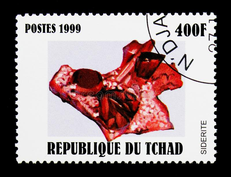 Siderite, Minerals serie, circa 2000. MOSCOW, RUSSIA - DECEMBER 21, 2017: A stamp printed in Chad shows Siderite, Minerals serie, circa 2000 stock image