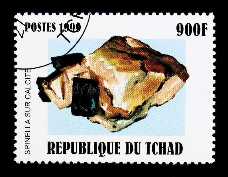 Spinel and calcite, Minerals serie, circa 1999. MOSCOW, RUSSIA - DECEMBER 21, 2017: A stamp printed in Chad shows Spinel and calcite, Minerals serie, circa 1999 royalty free stock photos