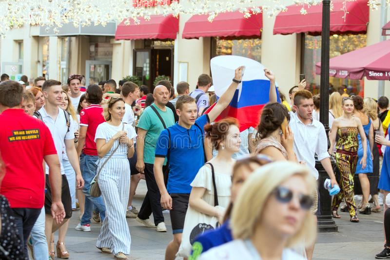 Fans of football on the Moscow street with Russian flag. World cup 2018. People wearing colorful clothes. 2018.06.17, Moscow, Russia. Fans of football on the stock photos