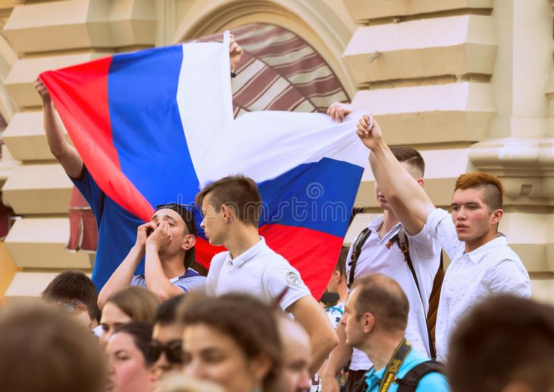 Fans of football on the Moscow street with Russian flag. World cup 2018. People wearing colorful clothes. 2018.06.17, Moscow, Russia. Fans of football on the royalty free stock photography