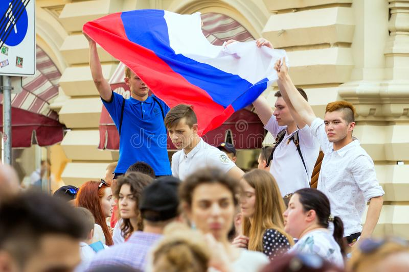 Fans of football on the Moscow street with Russian flag. World cup 2018. People wearing colorful clothes. 2018.06.17, Moscow, Russia. Fans of football on the royalty free stock images