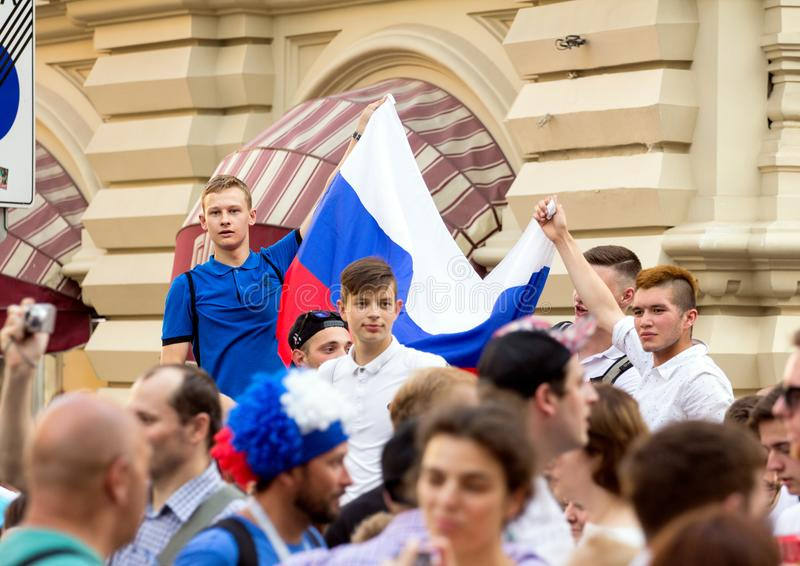 Fans of football on the Moscow street with Russian flag. World cup 2018. People wearing colorful clothes. 2018.06.17, Moscow, Russia. Fans of football on the stock photography