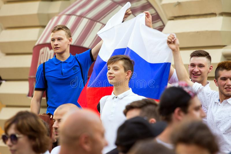 Fans of football on the Moscow street with Russian flag. World cup 2018. People wearing colorful clothes. 2018.06.17, Moscow, Russia. Fans of football on the royalty free stock photo