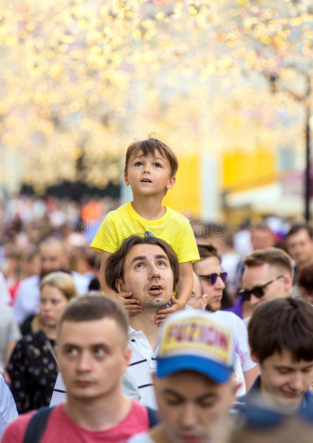 Fans of football on the Moscow street. World cup 2018. Cute boy sitting on the father`s shoulders. 2018.06.23, Moscow, Russia. Fans of football on the Moscow royalty free stock photos