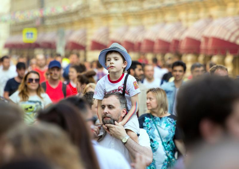 Fans of football on the Moscow street. World cup 2018. Cute boy sitting on the father`s shoulders. 2018.06.23, Moscow, Russia. Fans of football on the Moscow stock images