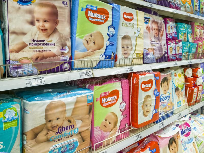 Moscow, Russia - Feb 12. 2019. diapers for children in large store network Auchan stock photography
