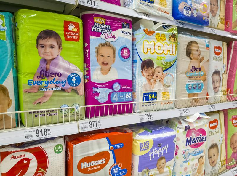 Moscow, Russia - Feb 12. 2019. diapers for children in large store network Auchan royalty free stock images