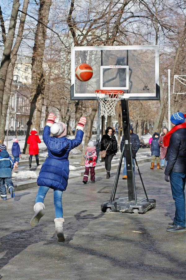 Girl playing basketball at Russian national festival `Shrove` on Tverskoy Boulevard in Moscow stock photography