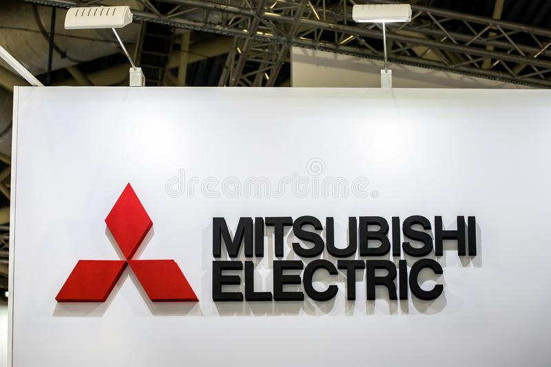 Mitsubishi logo japanese company sign on the wall stock photo