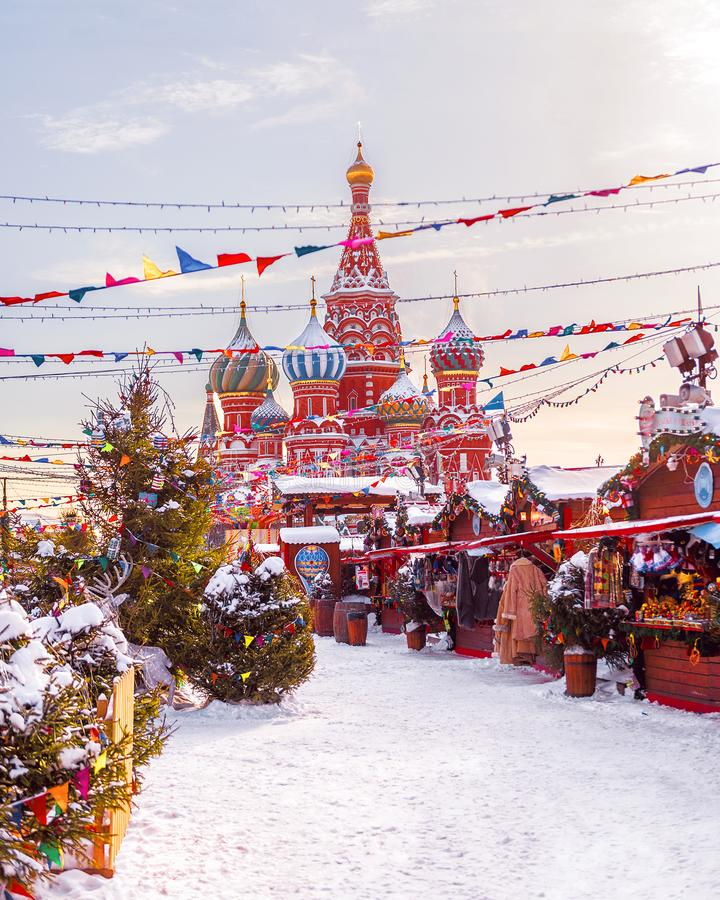 New Year`s Fair on Red Square. St. Basil`s Cathedral. Winter, snow,New Year`s Fair on Red Square. Winter, s stock photos