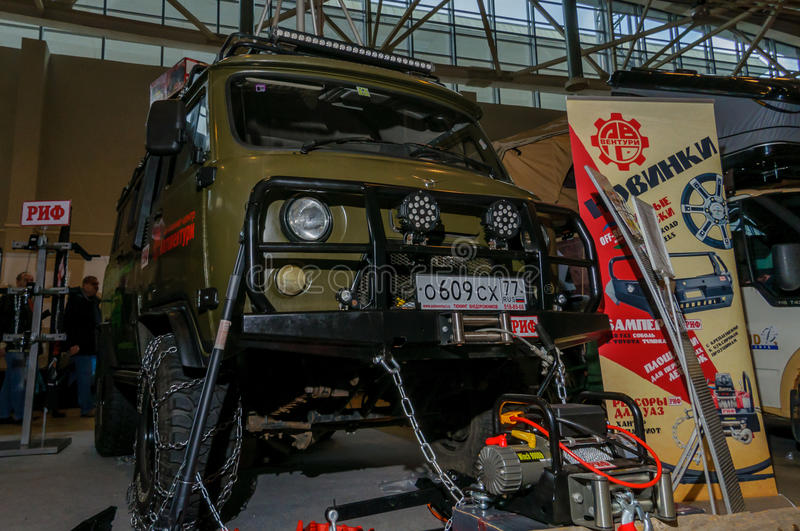 Moscow, Russia - February 25, 2017: Presentation of UAZ car with additional tuning at the exhibition Hunting and Fishing stock images