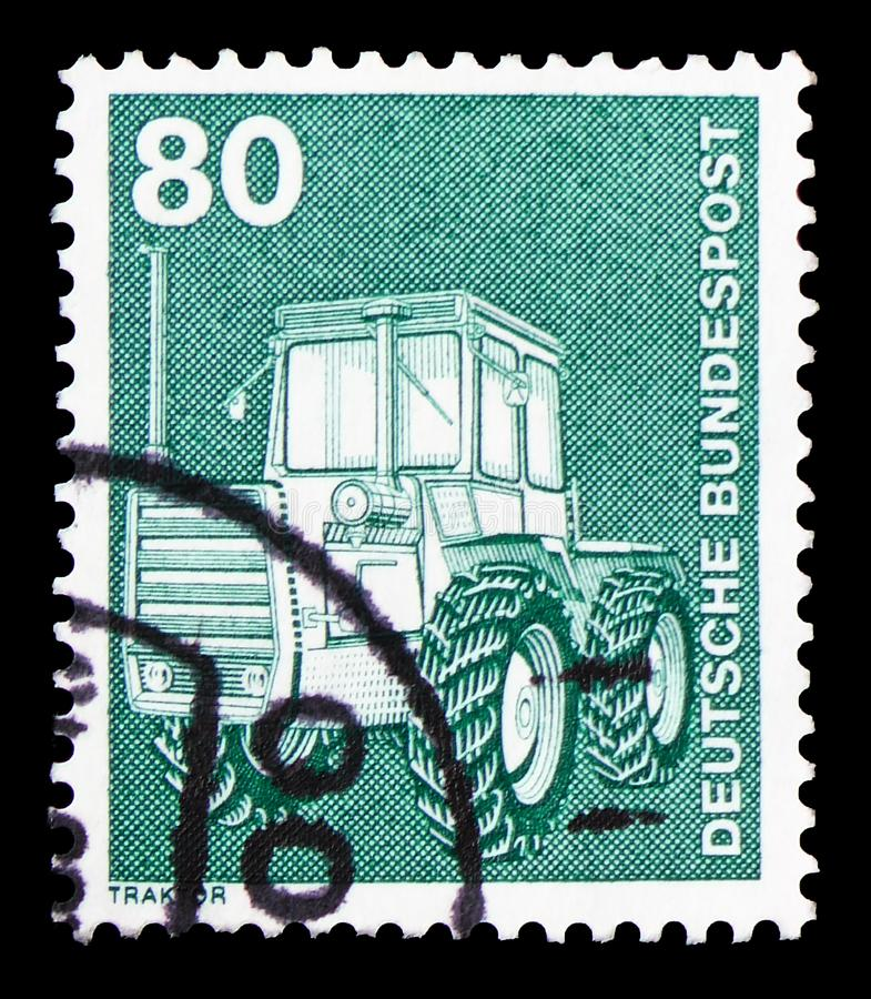 Tractor, Industry and Technology Definitives 1975-1982 serie, circa 1975. MOSCOW, RUSSIA - FEBRUARY 9, 2019: A stamp printed in Germany, Federal Republic, shows stock photography