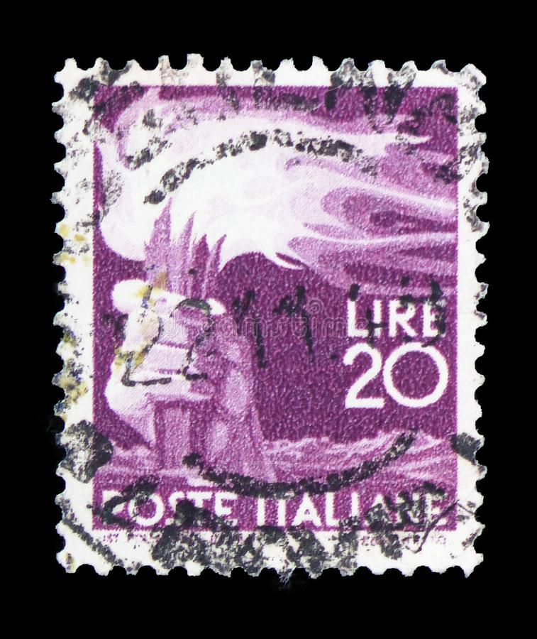 Hand holding a torch, 20 Lires, Democracy serie, circa 1945. MOSCOW, RUSSIA - FEBRUARY 10, 2019: A stamp printed in Italy shows Hand holding a torch, 20 Lires royalty free stock images