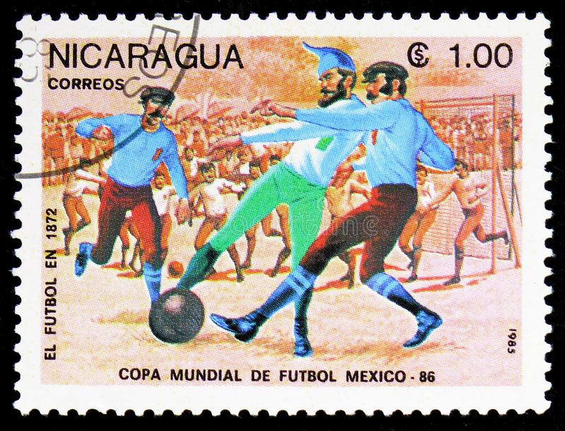 Evolution of Football, year 1872, FIFA World Cup 1986 - Mexico serie, circa 1985. MOSCOW, RUSSIA - FEBRUARY 9, 2019: A stamp printed in Nicaragua shows Evolution royalty free stock photo