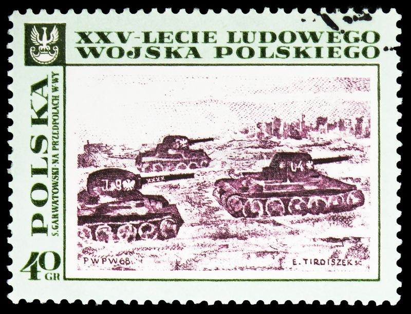 Tanks approaching Warsaw, by S. Garwatowski, Paintings Polish People's Army, 25th Anniversary serie, circa 1968. MOSCOW, RUSSIA - FEBRUARY 10, 2019: A stamp royalty free stock images