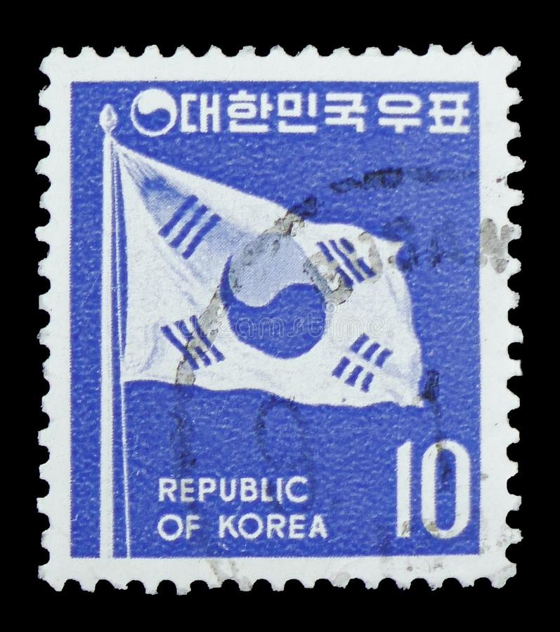 Flag of Korea, Definitives - Country Symbols serie, circa 1970. MOSCOW, RUSSIA - FEBRUARY 10, 2019: A stamp printed in South Korea shows Flag of Korea royalty free stock images