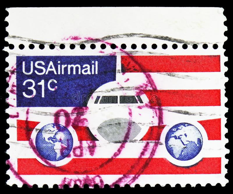 Plane, Globes and Flags, Airmail 1974-1976 serie, circa 1976. MOSCOW, RUSSIA - FEBRUARY 10, 2019: A stamp printed in United States shows Plane, Globes and Flags stock images