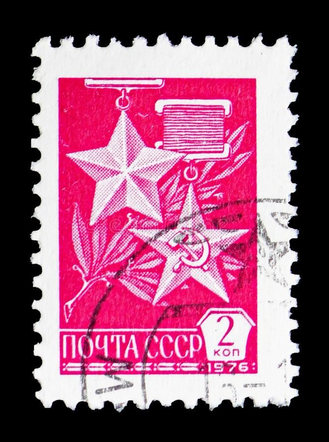 `Gold Star` and `Hammer and Sickle` medals, Definitive Issue No.12 serie, circa 1976. MOSCOW, RUSSIA - FEBRUARY 14, 2019: A stamp printed in USSR Russia shows ` stock image