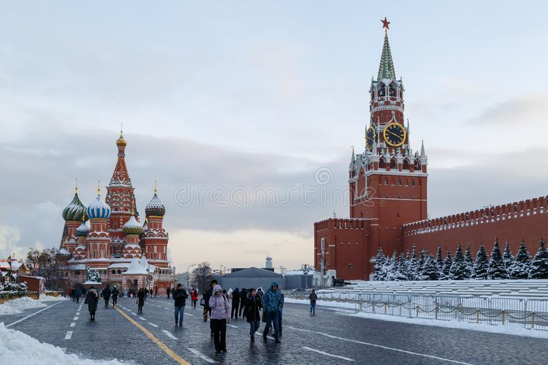 Tourists are walking on The Red Square on a cold winter evening stock photography
