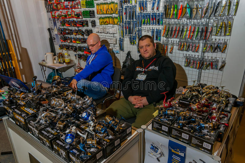 Moscow, Russia - February 25, 2017: Two sellers of fishing gear waiting for customers behind the counter stock image