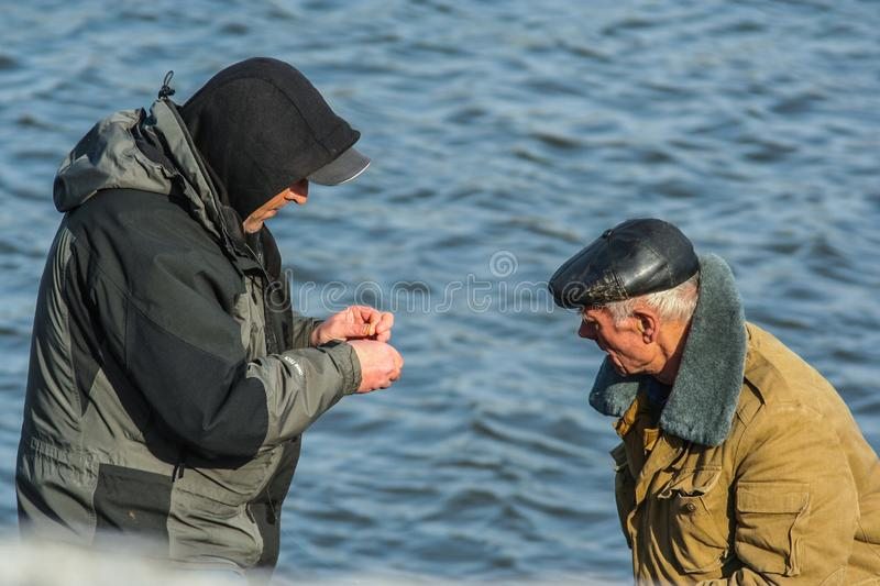Fishermen on the river bank. Spring entertainment of Russian people. 2010.03.27, Moscow, Russia. Fishermen on the river bank. Spring entertainment of Russian royalty free stock images