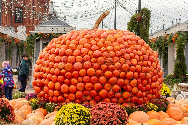 12-10-2019, Moscow, Russia. Golden Autumn Festival. A huge pumpkin collected from small orange pumpkins, a festive decoration in t royalty free stock image