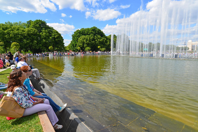 MOSCOW, RUSSIA - 26.06.2015. Gorky Park -Central. Park of Culture and Rest. People relax by the fountain royalty free stock photo