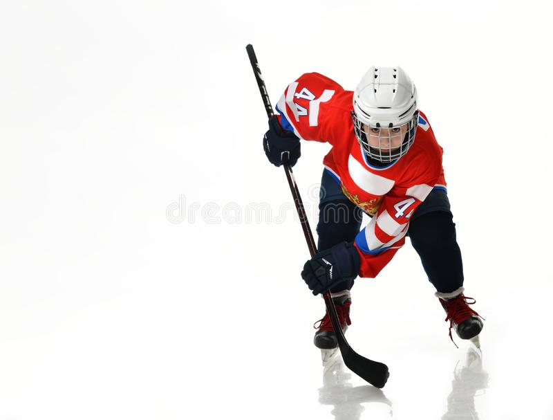 Boy hockey player in studio silhouette isolated on white background stock image