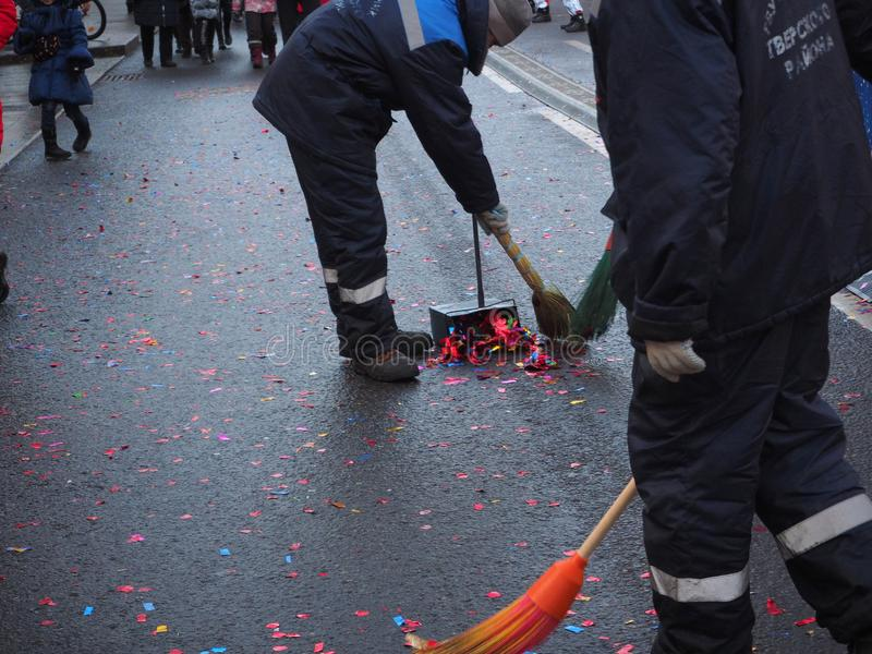 MOSCOW, RUSSIA, JANUARY 5, 2020. City services remove confetti from the streets during Christmas festival in Moscow. People at work during the holidays royalty free stock photography