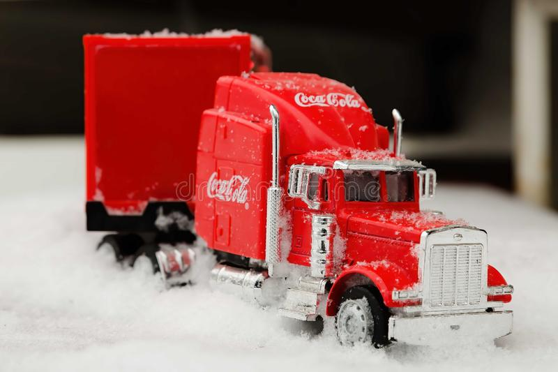 Moscow, Russia - January 02, 2019: Coca-Cola Christmas truck. A toy in red color rides in the real snow drifts. Outdoors, new year royalty free stock photos