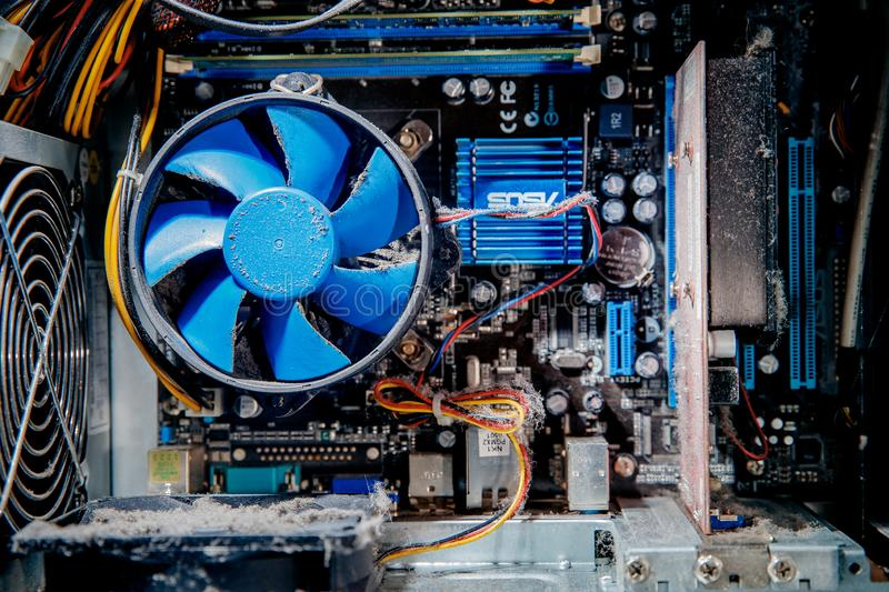 Moscow, Russia - January 1, 2019: Dust on computer pc processor cooler with mainboard, Component maintenance. stock images