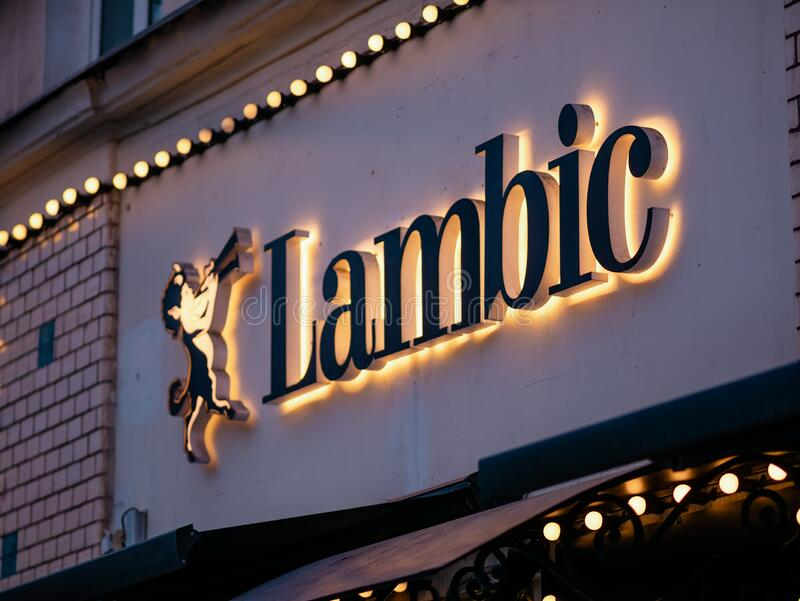 Moscow, Russia - January 17, 2020: Lambic sign above the entrance to a street restaurant in the city. Backlight from many light royalty free stock photos