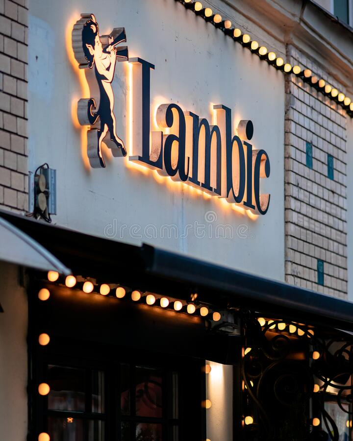 Moscow, Russia - January 17, 2020: Lambic sign above the entrance to a street restaurant in the city. Backlight from many light royalty free stock photography