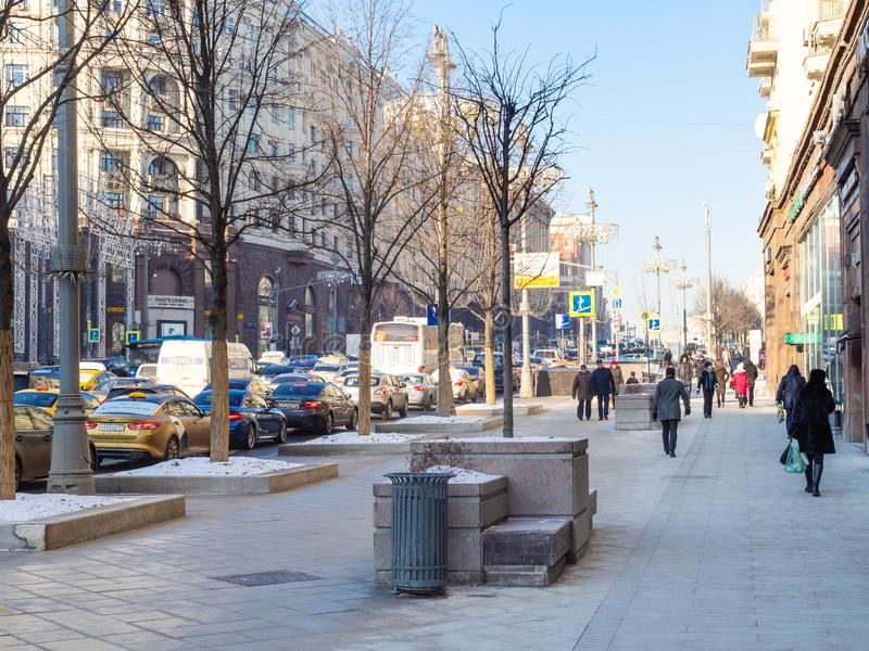 People walk at Tverskaya street in Moscow city. MOSCOW, RUSSIA - JANUARY 24, 2019: people walk at Tverskaya street in Moscow city in sunny winter day. Tverskaya royalty free stock image