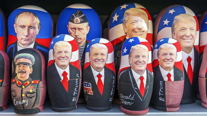 MOSCOW, RUSSIA-JANUARY 17, 2017: Russian traditional toy - Matryoshka with a portrait of Putin and Trump. showcase souvenir kiosk royalty free stock image