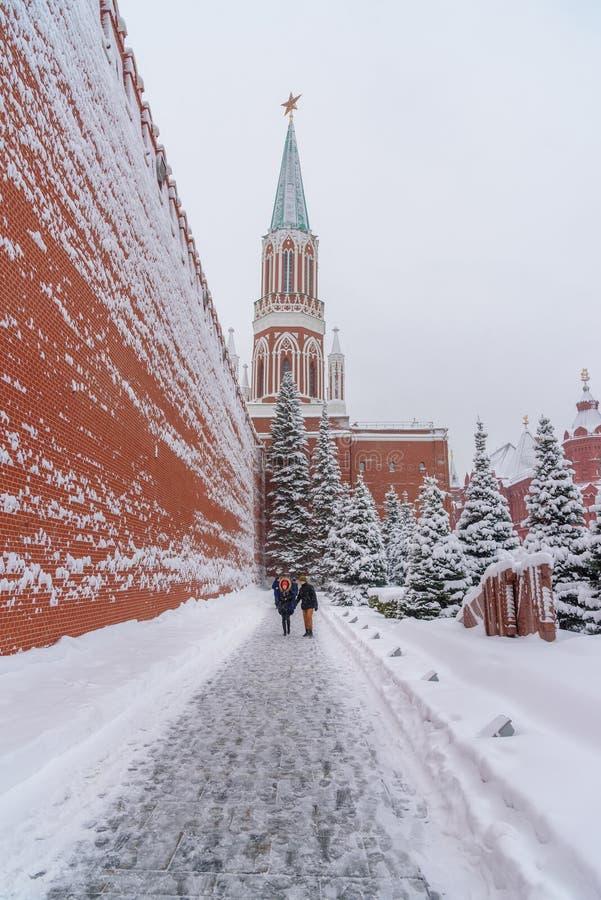 View of Kremlin wall and Nikolskaya Tower. People go to Lenin`s Mausoleum near Kremlin wall in winter. Moscow. Russia stock photo
