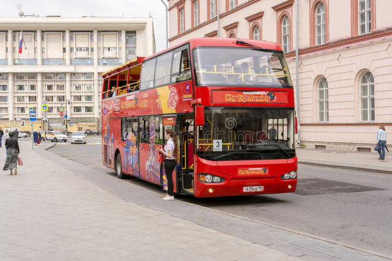 Moscow, Russia. July 17, 2019. Double-Decker bus on the streets. Girl Manager invites guests on a tour royalty free stock images