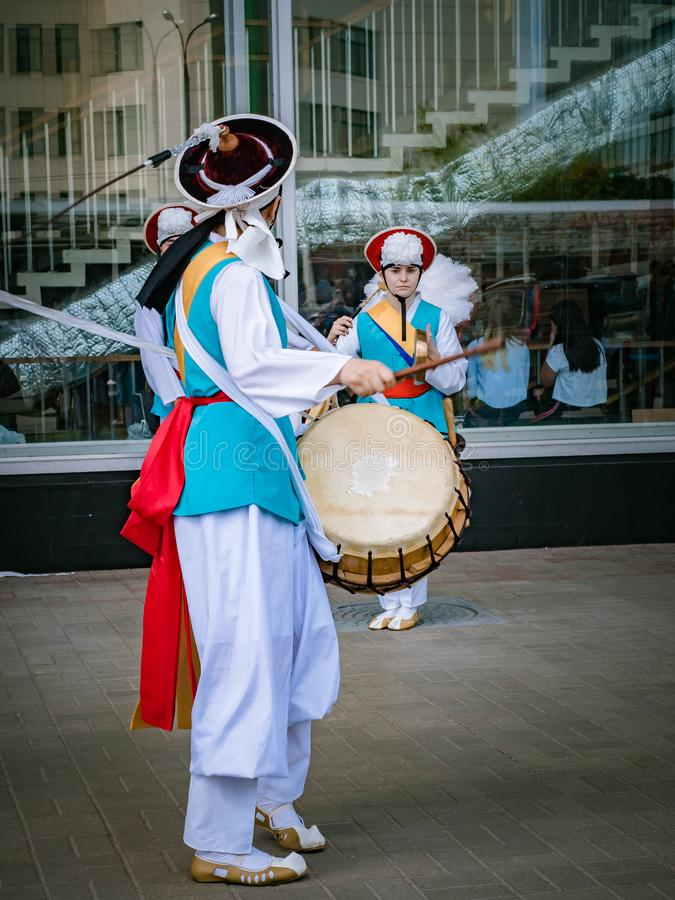 Moscow, Russia, July 12, 2018: Korean traditional musical instruments. A group of musicians and dancers in bright stock images