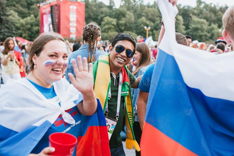 MOSCOW, RUSSIA - JULY 2018: Mexican fan among Russian fans and flag in the fan zone during the World Cup. MOSCOW, RUSSIA - JULY 2018 Mexican fan among Russian stock images